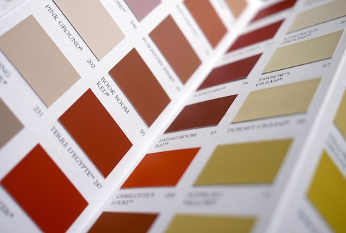 Color swatch book with warm interior paint color options.